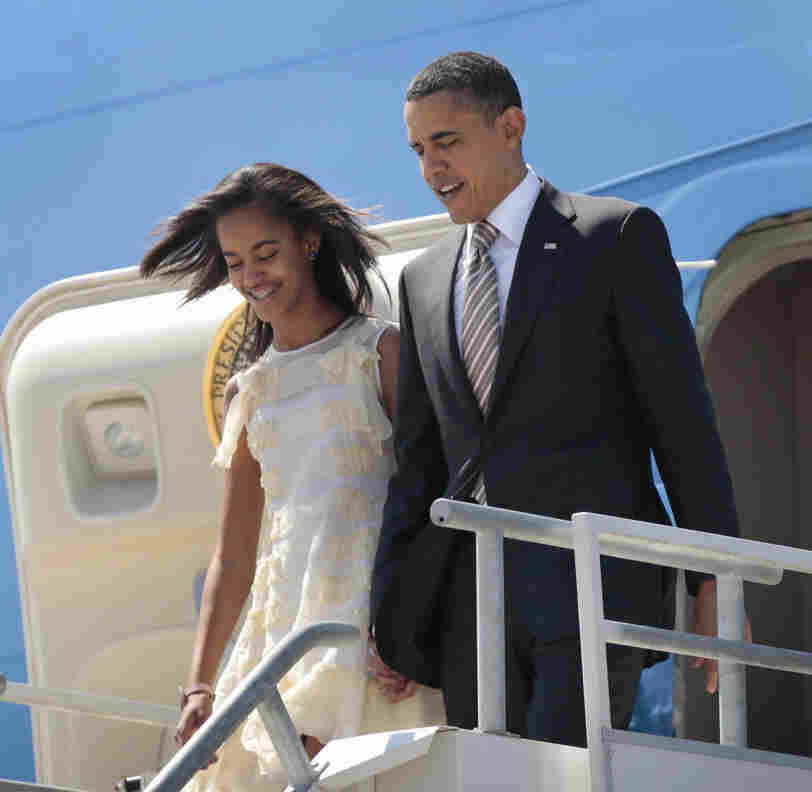 "President Barack Obama and his daughter Malia arrive in Santiago, Chile. Asked how he would feel about Malia starting to date, the president quipped, in a reference to the Secret Service, that ""I have men with guns who surround them all the time ... and it means they never get in a car with a boy who had a beer."""