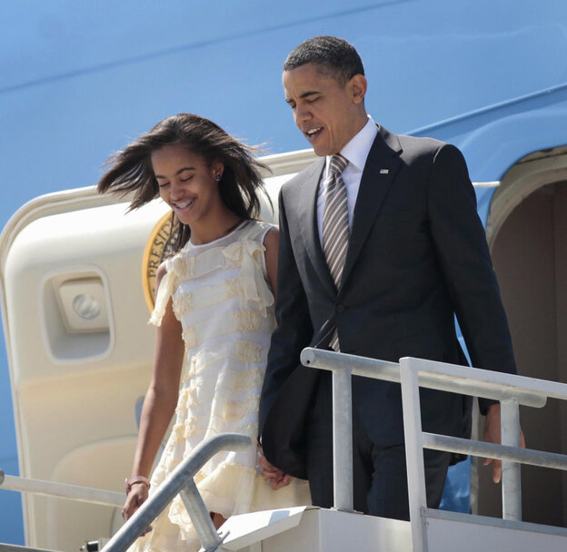 """President Barack Obama and his daughter Malia arrive in Santiago, Chile. Asked how he would feel about Malia starting to date, the president quipped, in a reference to the Secret Service, that """"I have men with guns who surround them all the time ... and it means they never get in a car with a boy who had a beer."""""""