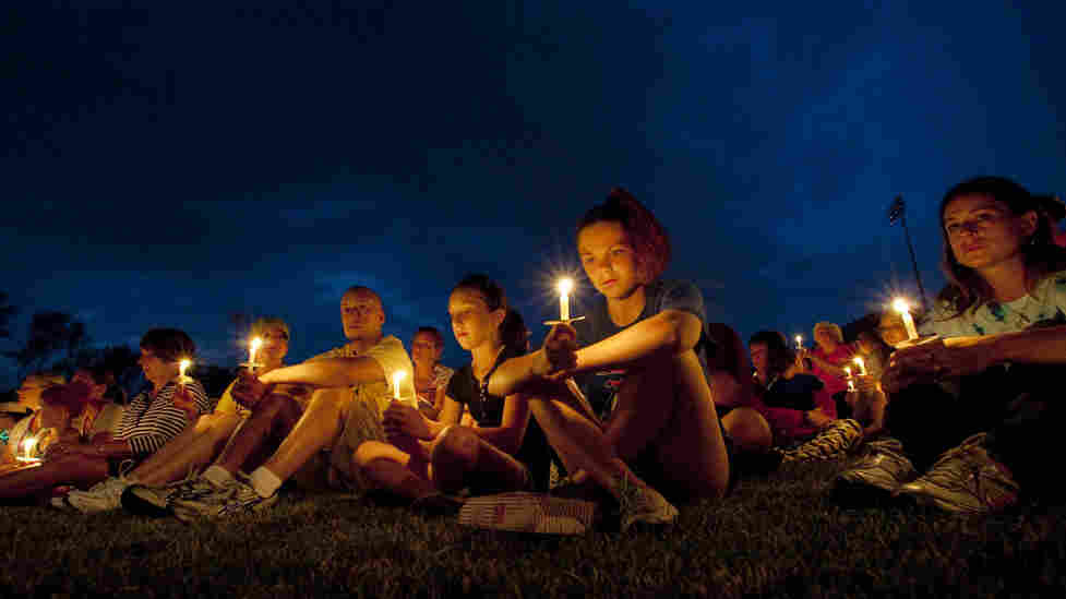 In remembrance of cancer victims, participants in an American Cancer Society Relay for Life hold candles at Olmsted Falls High School in Olmsted Falls, Ohio, last Saturday.