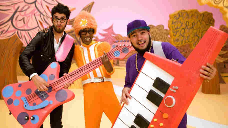 The dance-rock duo Chromeo goofs around on the set of Yo Gabba Gabba! with host DJ Lance Rock (center).