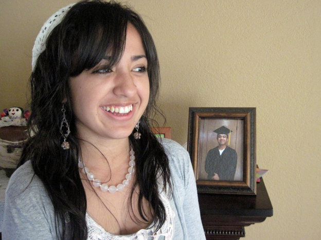 Desiree Lucero, 17, is inspired to go to college by her father, Felix, shown wearing the graduation cap and gown in the framed photo. Felix earned his Associate's Degree from San Quentin's college program in 2009. He has been incarcerated since Desiree was a year old.