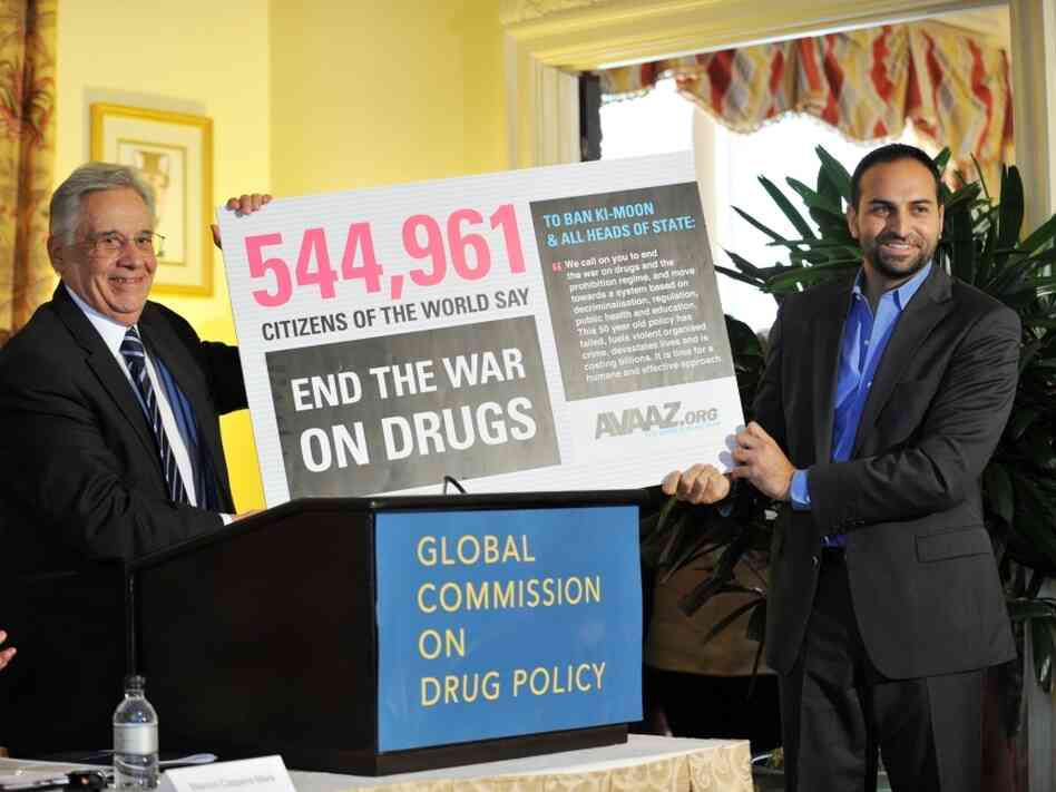 Fernando Henrique Cardoso (L), former president of Brazil and chair of The Global Commission on Drug Policy, accepts petition to end the war on drugs from Ricken Patel on June 2, 2011. The Commission launched a new report that describes the drug war as a failure and calls for a paradigm shift in global drug policy.