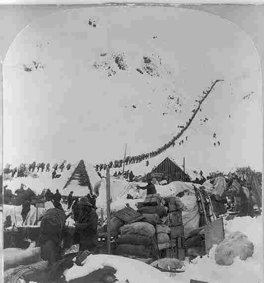 A long line of 19th-century prospectors make their way to Canada's Klondike gold fields through the Chilkoot   Pass in Alaska.