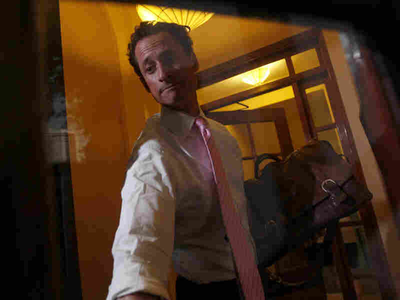 Rep. Anthony Weiner (D-NY) closes the front door of his building when arriving home in New York on June 9. On Thursday, Weiner announced his resignation from Congress because of an extramarital sexting scandal.