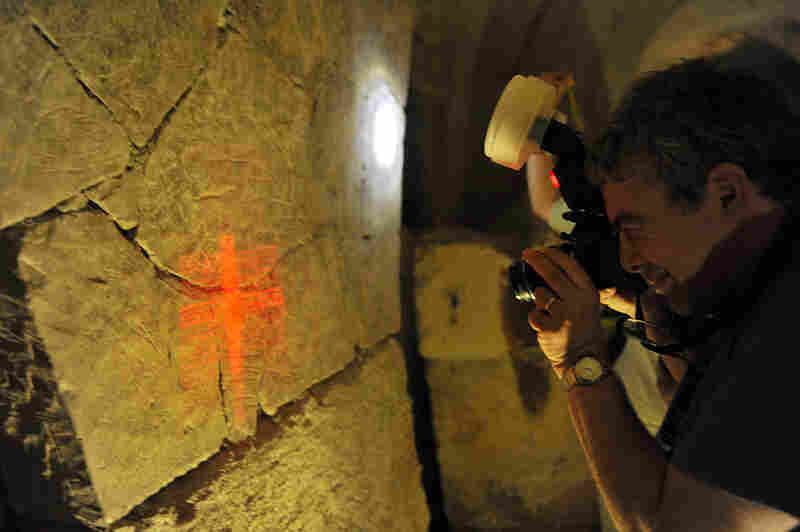 "Stern's husband, Dr. Ezra Gabbay, photographs a graffito in Beit She'arim — also known as the cave of the coffins. Photographing graffiti is exceedingly difficult and requires multiple raking light sources and filtered light. The graffiti in this cave include those by the entrance, which read, ""Good luck on your resurrection."""