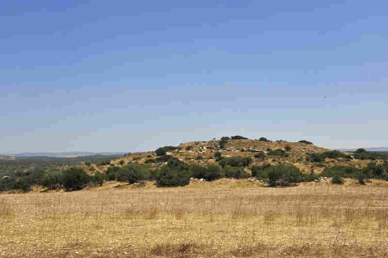 """In Israel, """"tels"""" like this one are manmade hills, which would have been the foundation upon which villages rested. Burial tombs were carved out of the soft chalk outside the villages."""
