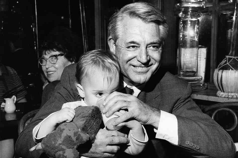 "Jennifer Grant, daughter of actor Cary Grant, says she titled her book after one of her father's favorite expressions, ""good stuff,"" which he used to declare his happiness. Here, Grant sits with his daughter at a restaurant in the 1960s New York."