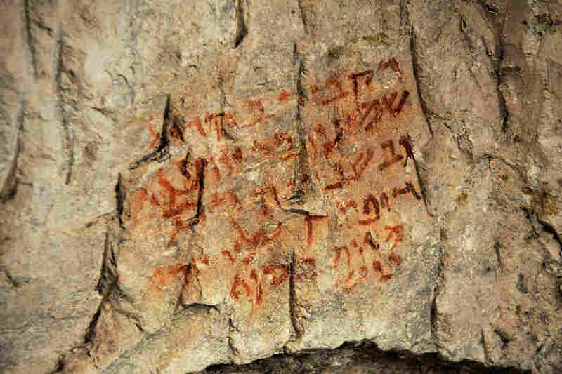 "A painted inscription above a burial space in Beit She'arim is written in Aramaic and translates to: ""The one who is buried in this [place] is Shim'on, the son of Yohanan; and on oath, whoever shall open upon him shall die of an unfortunate end."""