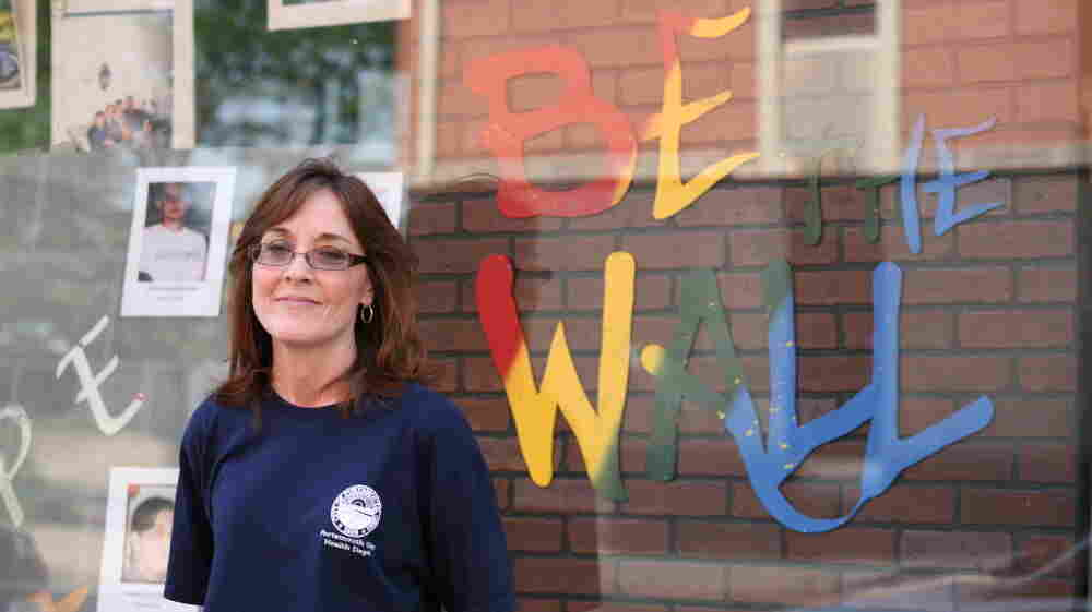 Portsmouth Public Health Nurse Lisa Roberts helped found the Scioto County Prescription Drug Action Team. Behind her is a memorial to victims of prescription drug abuse.