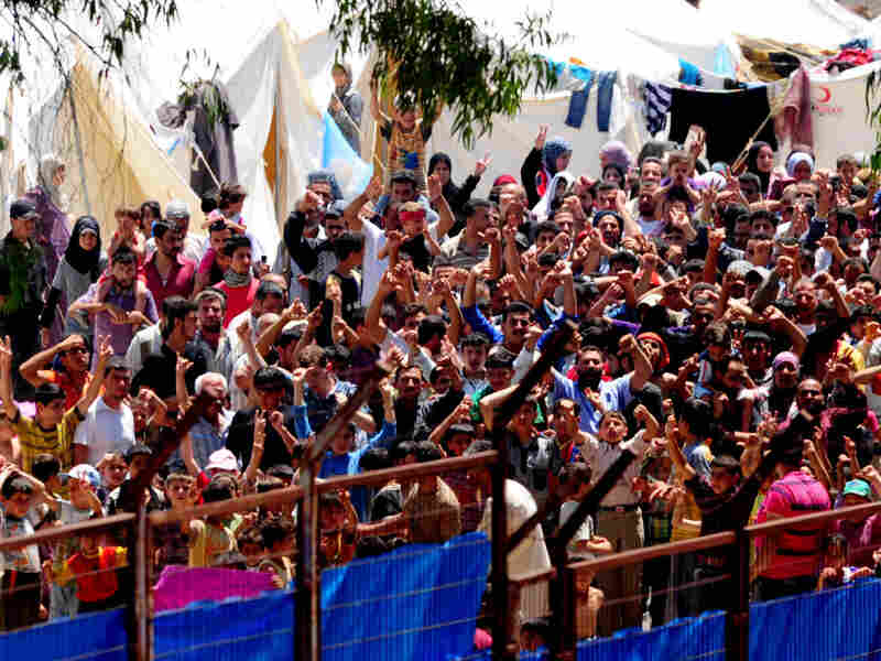 Syrian refugees gather for a protest against Syrian President Bashar al-Assad at the Turkish Red Crescent camp in the Yayladagi district of the Turkish city of Hatay, near the Syrian border, on June 20.