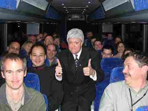 Bob Heck impersonates Bill Clinton during a bus tour.
