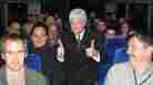 Bob Heck impersonates Bill Clinton during a bus tour.