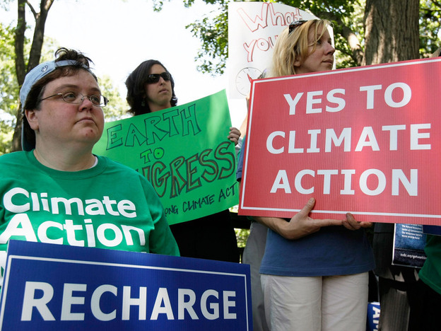 In 2008, activists held posters as the Senate opened debate on the bipartisan Climate Security Act. Back in 2006, 77 percent of the public believed in global warming. Today, less than 60 percent do, according to Pew Research.