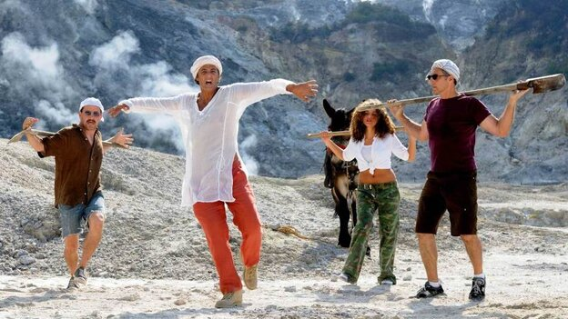 """Enter Sandmen: Musical performances make up the bulk of Passione, and director John Turturro often can't resist getting in on the action. Max Casella (from left), Fiorello, an unnamed dancer and Turturro search for Neapolitan oil in the song """"Caravan Petrol."""""""