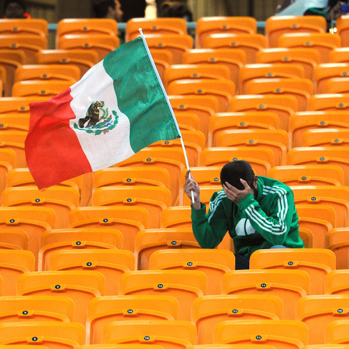A fan reacts to Mexico's defeat at the 2010 World Cup.