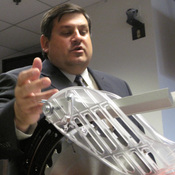 Thomas Siwek, director of product safety at Robert Bosch Tool Corp., demonstrates a newly designed guard for table saws at a meeting with the Consumer Product Safety Commission. Industry officials say the new guards make the saws safe. But consumer advocates disagree and are pushing for flesh-sensing technology such as SawStop, which they say will virtually eliminate the worst table saw injuries.