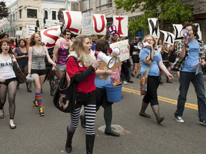"Protesters march at the SlutWalk in Seattle on June 19. SlutWalks began in April when a Toronto police officer suggested women ""avoid dressing like sluts"" to not be victimized."
