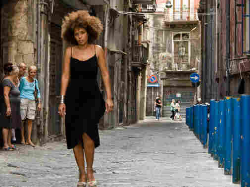 Passione hails Naples as a cultural playground for artists like M'Barka Ben Taleb, a Tunisian singer who combines Arab and Neapolitan influences.