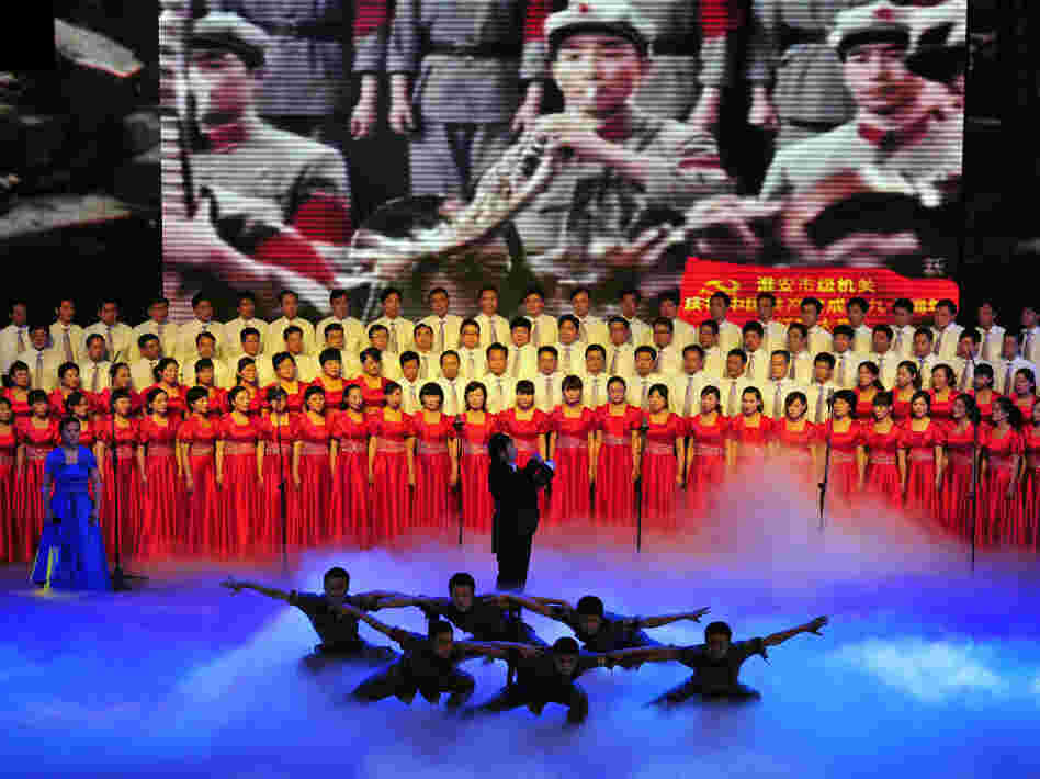 "Officers from Huaian city perform patriotic ""red songs"" at the Huaian Great Hall of the People to mark the 90th anniversary of the founding of the Communist Party of China."
