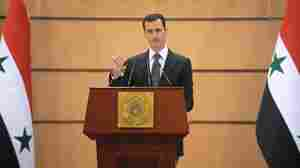 The official Syrian News Agency (SANA) released a photo showing Syrian President Bashar Assad addressing the nation from Damascus University on Monday.