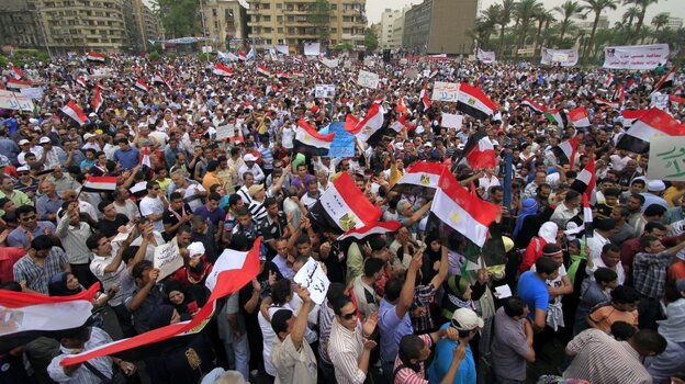 Egyptian protesters wave national flags as they attend a rally in Tahrir Square in Cairo on May 27.