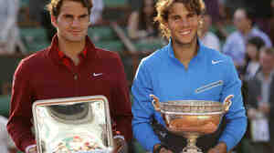 Spain's Rafael Nadal (right) and  Switzerland's Roger Federer pose with their trophies after the men's final match at the 2011 French Open.  The two men are currently playing in the 2011 Wimbledon Championships.