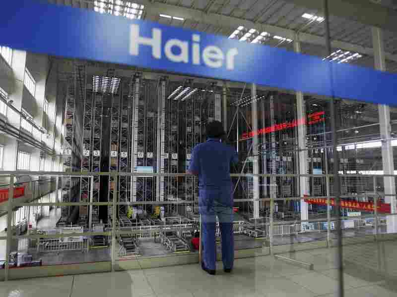 A worker stands in a warehouse at China's Qingdao Haier refrigerator factory. Despite being the world's largest maker of refrigerators, Haier is not widely known as a Chinese company.