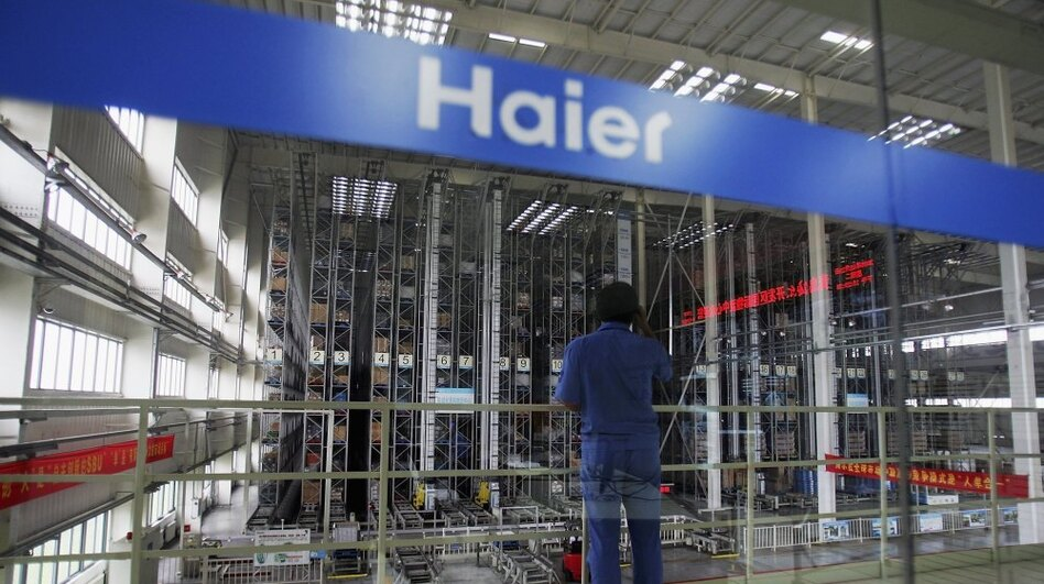 A worker stands in a warehouse at China's Qingdao Haier refrigerator factory. Despite being the world's largest maker of refrigerators, Haier is not widely known as a Chinese company. (Getty Images)