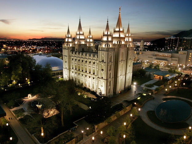 The sun sets behind the Mormon Temple in Salt Lake City, April  2006.