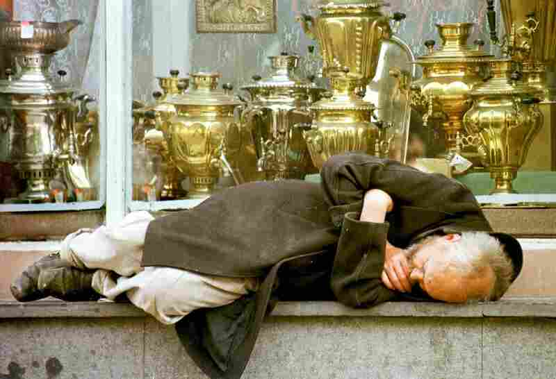 RUSSIA, defaulted in 1998.  A homeless man sleeps in the window of an antiques shop on downtown Moscow's Arbat street. Although Prime Minister-delegate Yevgeny Primakov had said during Russia's ruble crisis that reform was at the top of his economic priorities, the country ultimately defaulted.