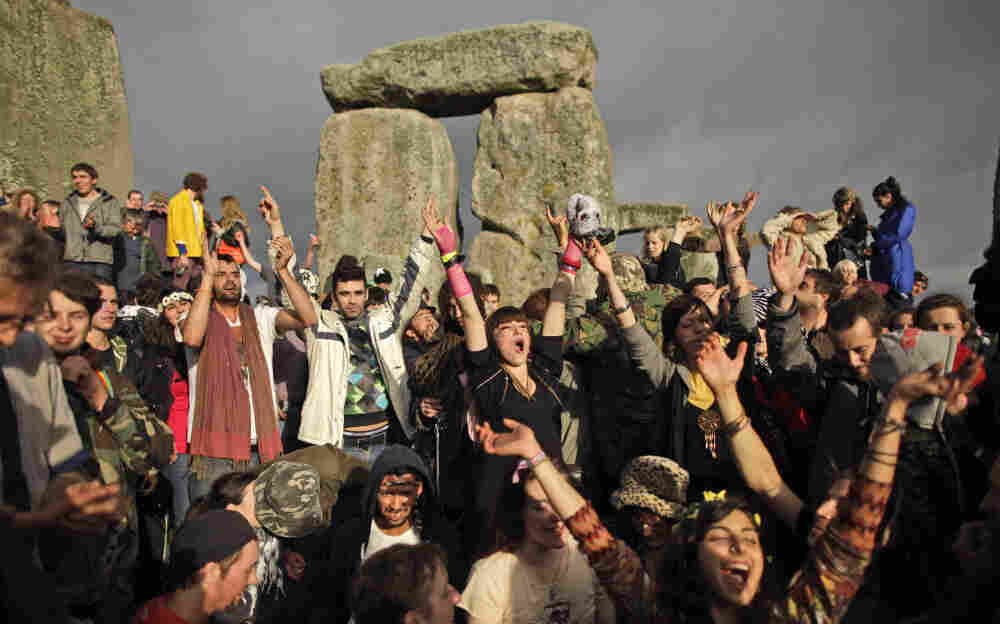 Revelers at Stonehenge, near Salisbury in England, cheered Tuesday as the sun finally broke through the clouds several hours after sunrise on the summer solstice.