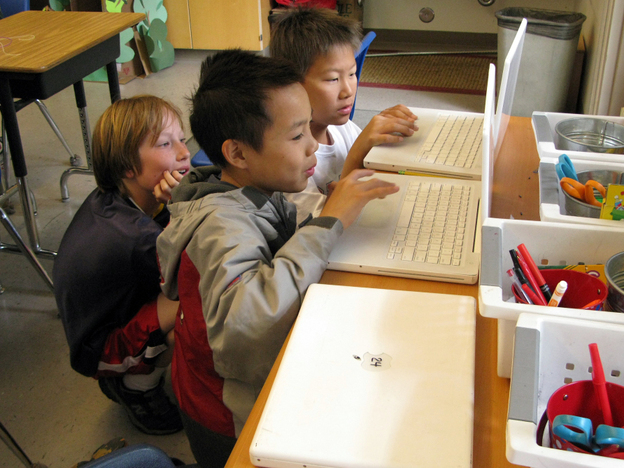 Fifth-graders (from left) Reese Toomre, Lucas Nguyen and Michael An race through the Khan  Academy's Trigonometry Challenge. The program allows more advanced students to  move ahead, while other students can proceed at their own pace.