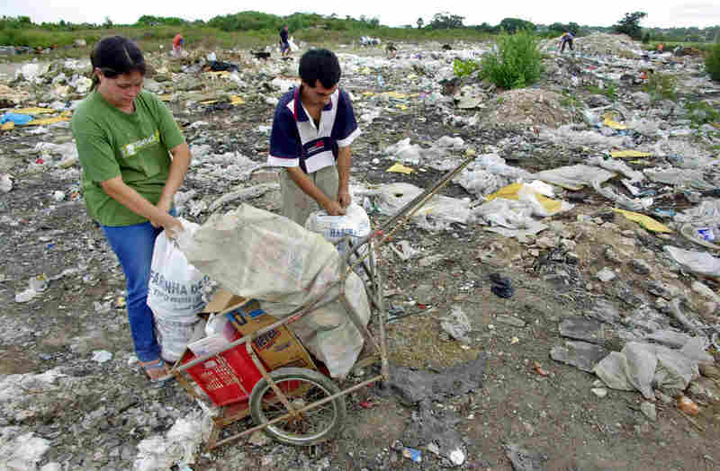 URUGUAY, nearly defaulted in 2003.  Letisia Rodriguez, 18, and Ernesto Baez, 24, collect bottles, cardboard and food they find in a garbage dump in Montevideo. The economic crisis that affected Uruguay increased unemployment, forcing some Uruguayans to root through garbage to sustain their families.