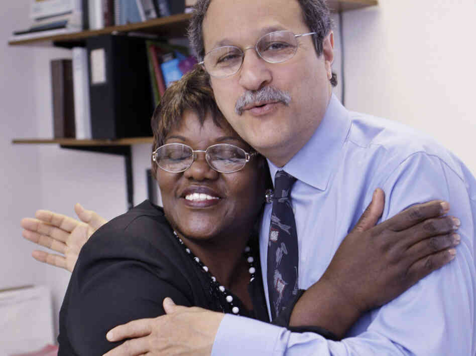 Wal-Mart employee Betty Dukes, left, hugs her attorney Brad Seligman in his Berkeley, Calif. office on Monday, June 20, 2011. The Supreme Court blocked Dukes' sex discrimination lawsuit against Wal-Mart yesterday.