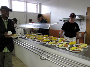 Steven White (right)  helps serve dinner at the Salvation Army soup kitchen.