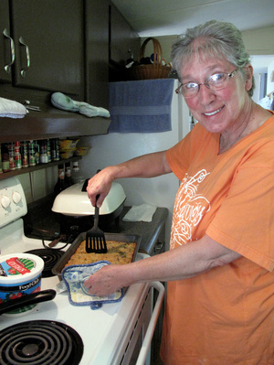 Cindy Tipton prepares a casserole of cornmeal and yellow  squash that she picked up from the mobile food pantry.