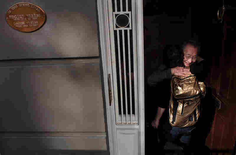 Chase is embraced by composer Chou Wen-chung when she arrives at his home in SoHo. A plaque outside commemorates Chou's teacher, legendary avant-garde composer Edgard Varese, who used to live there.