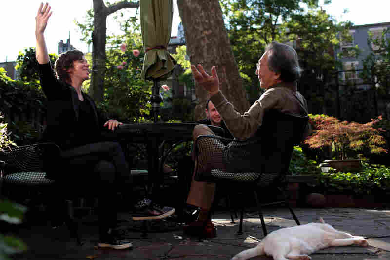 In the garden behind the house, Chase, Rubin and Chou discuss an upcoming performance of Varese's works by ICE.