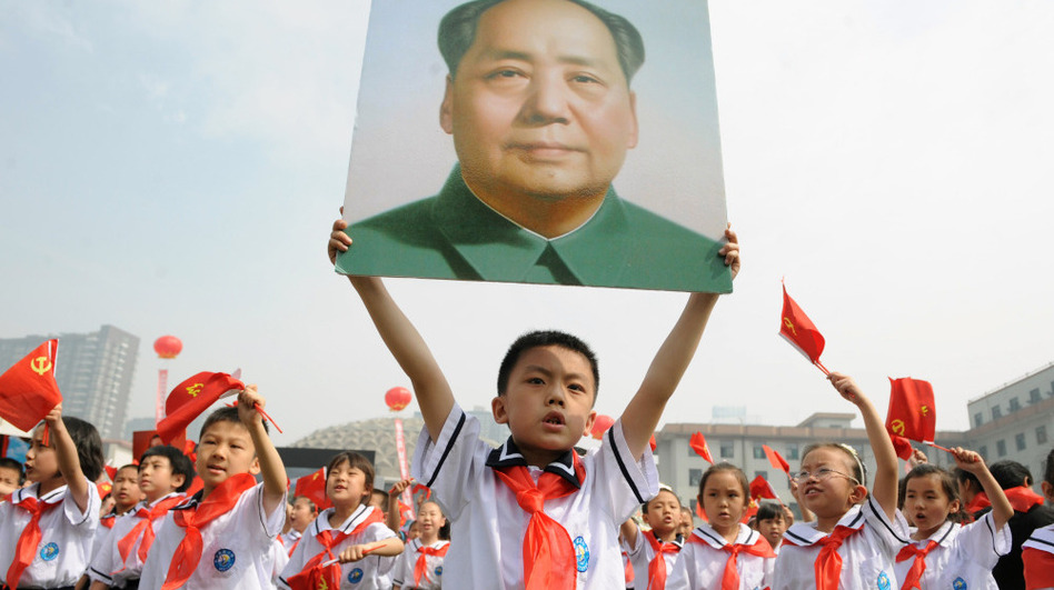 Thousands of Chinese students holding Communist flags and a portrait of China's late leader Mao Zedong mark the 90th anniversary of the founding of China's Communist Party. Celebrations like this one come during a controversial moment, as leftist groups push back at criticism of Chairman Mao and the millions of deaths he caused. (AFP/Getty Images)