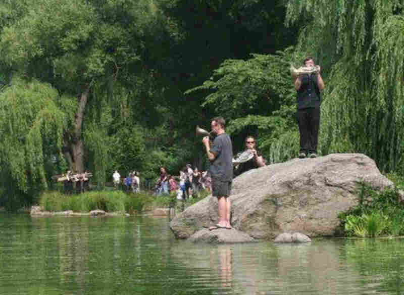 Gregory Evans, Sarah Baird Knight, and Nathan Koci perform 'Swelter,' a new ambient piece written to be played on the Central Park Lake, as part of Make Music New York on June 21.
