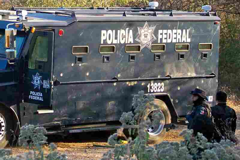Killed Dec. 9, 2010: Nazario Moreno Gonzalez, the founder and leader of the cultlike La Familia cartel, is slain by federal police after a two-day shootout. Federal police officers stand near a bullet-riddled vehicle a day after the operation in Apatzingan, Mexico.