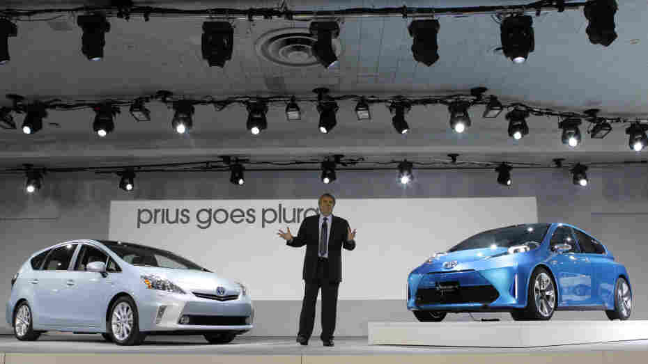 Bob Carter, group vice president and general manager, Toyota Division, introduces the Prius v midsize hybrid-electric vehicle (left) and the Prius C Concept vehicle at the North American International Auto Show in Detroit on Jan. 10.