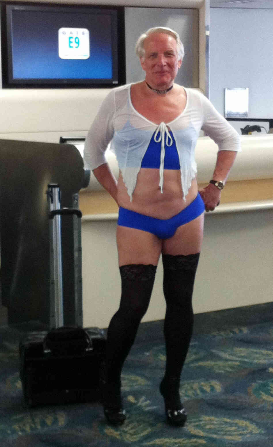 This is a June 9, 2011, photo provided by airline passenger Jill Tarlow showing an unnamed passenger scantily dressed and taken at the airport in Fort Lauderdale, Fla.