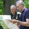 Edward Barnard (left) and Ken Chaya look at their map of Central Park as they stand in its North Woods.