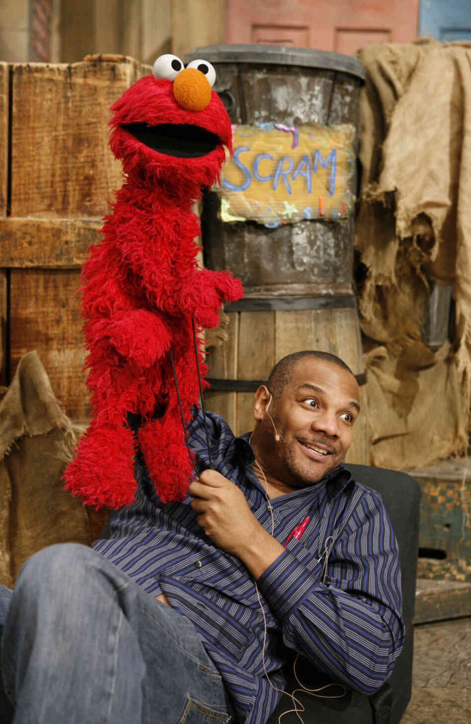 Elmo and Kevin Clash, photographed on the Sesame Street set in 2006.