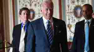 Vice President Biden arrives at the Capitol on Wednesday for a meeting with legislators to work on a framework for deficit reduction. At left is his chief of staff, Bruce Reed.