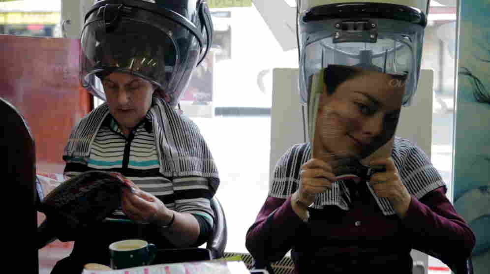 Two women relax under the hair dryers in the delightful Blue Rinse.