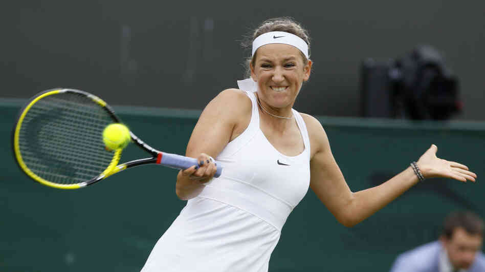 Victoria Azarenka of Belarus returns a shot to Slovakia's Magdalena Rybarikova during their first round match at the All England Lawn Tennis Championships at Wimbledon Monday.