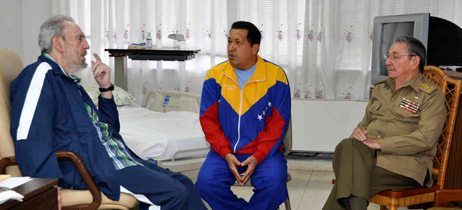 Ailing Venezuelan President Hugo Chavez Frias chatting with Cuban former President Fidel Castro (L) and his brother and current President of Cuba, Raul Castro (R), on June 17, 2011. This photo was released by the Cuban government.