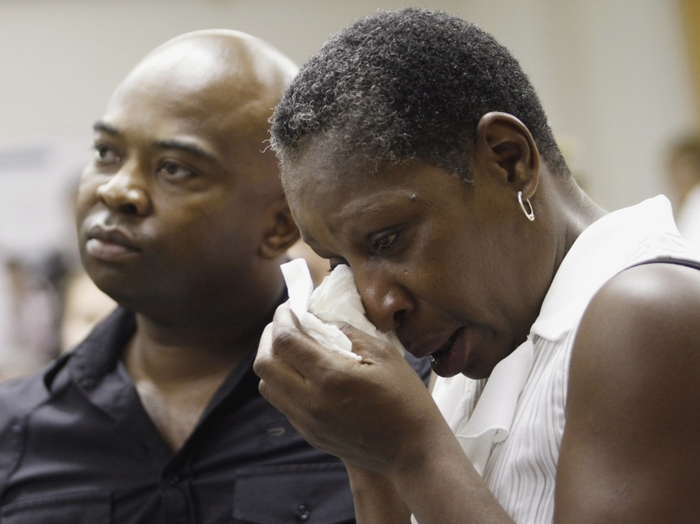 Elaine Riddick sits with her son, Tony Riddick, at a hearing before a state panel in Raleigh, N.C., on Wednesday.